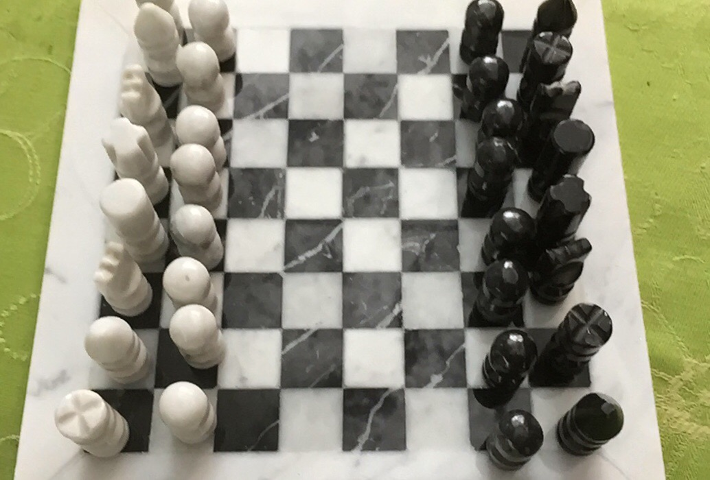Handmade chessboard , carved pieces